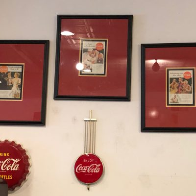3 framed Coke Ads